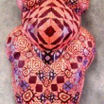 Feminine goddess covered with polymer clay millefiore by Carolyn Potter