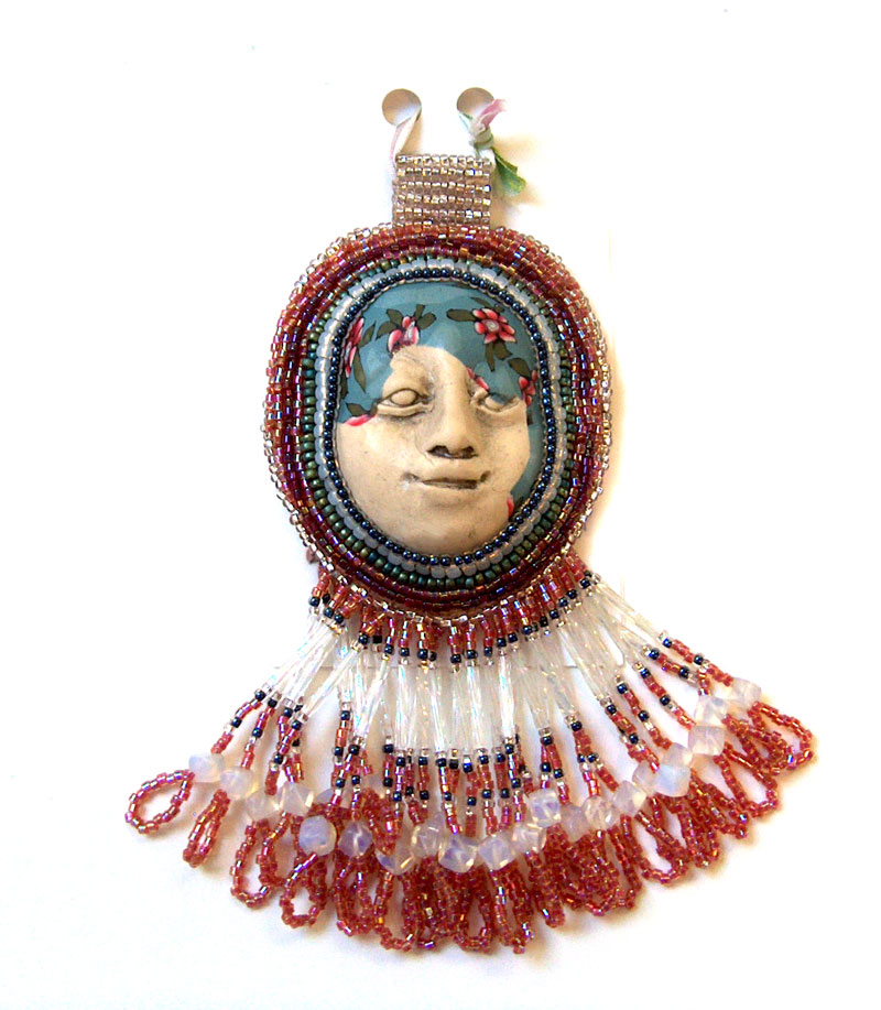 beaded face pendant by Laura Humenik